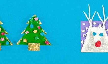 Tarjetas de Navidad DIY hechas de cartón, papel de seda y purpurina con forma de árboles de Navidad y un reno blanco